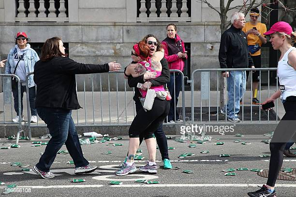 A runner embraces another woman on the marathon route near Kenmore Square after two bombs exploded during the 117th Boston Marathon on April 15 2013...