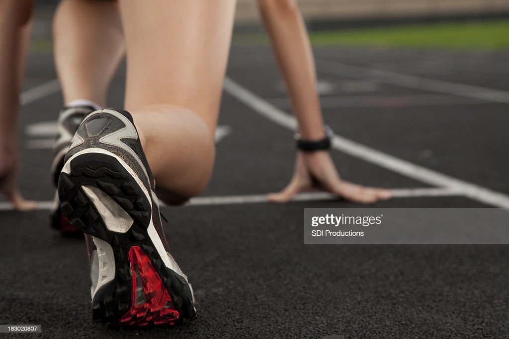 Runner Feet Closeup at the Start of a Track Race