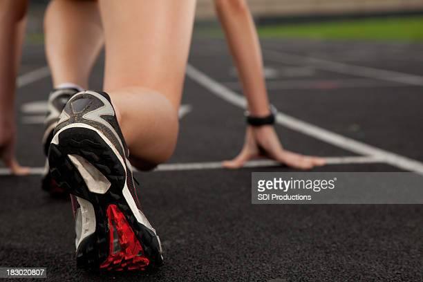 Runner Feet Closeup at the Start of a Track Race