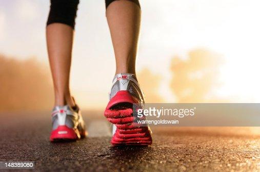 Runner feet sunrise : Stock Photo