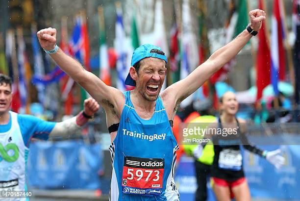 A runner finishes the 119th Boston Marathon on April 20 2015 in Boston Massachusetts