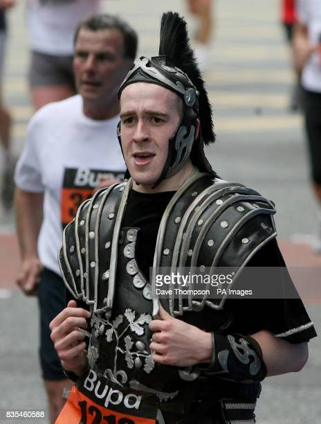 A runner in fancy dress takes part in the Manchester 10k run during the BUPA Great Manchester Run and Great City Games in Manchester