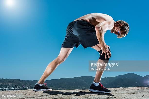 Corridore nel dolore al ginocchio