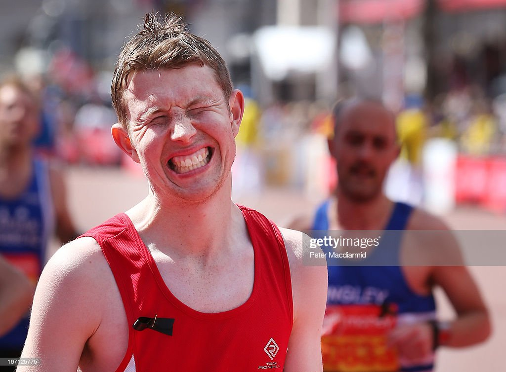 A runner in the London Marathon grimaces as he crosses the finish line on April 21, 2013 in London, England. Thousands of runners are taking part - with some wearing black ribbons as a mark of respect to the Boston victims. Extra police are on duty as an estimated 500,000 people line the streets of the capital.