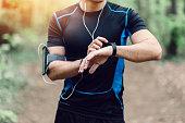 Runner in the park preparing for jogging