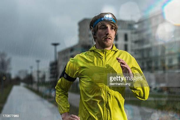 Runner jogging in the rain