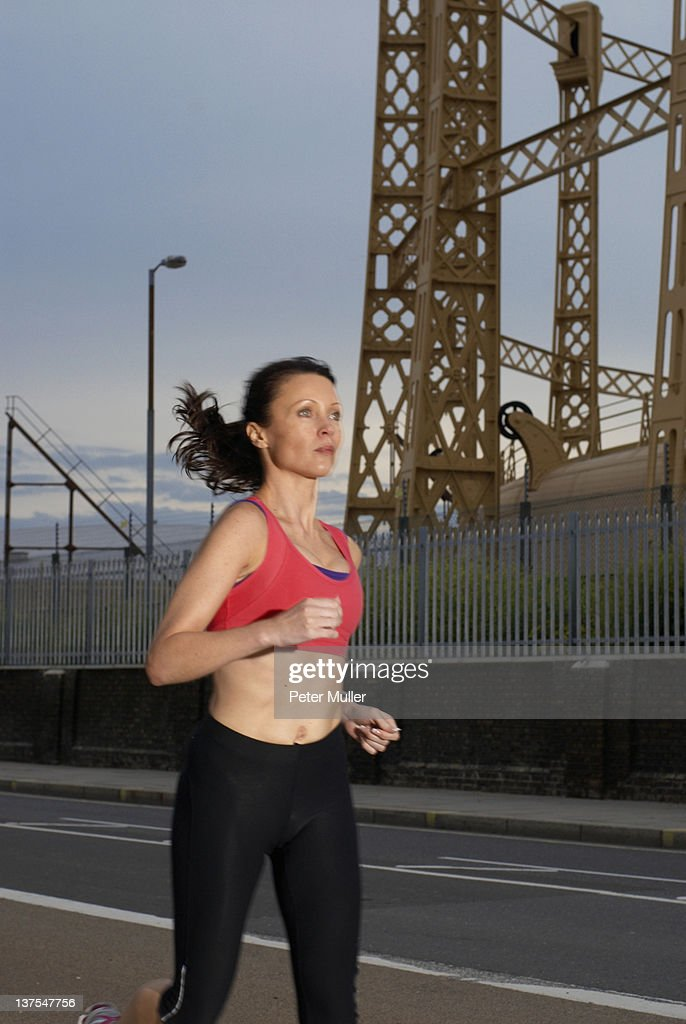 Runner jogging on city street : Stock Photo