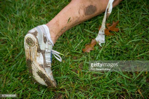 A runner lays on the grass after competing during the Division I Men's Cross Country Championship held at EP Tom Sawyer Park on November 18 2017 in...