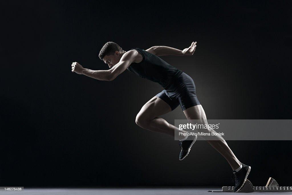 Runner leaving starting block