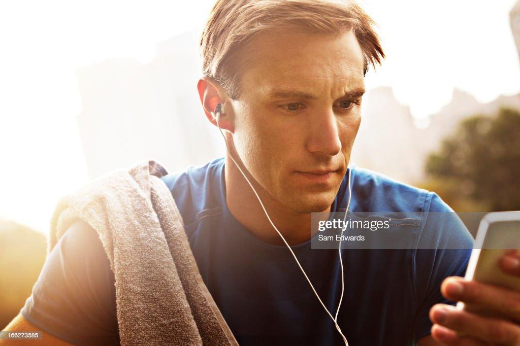 Runner listening to mp3 player