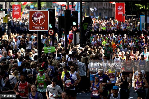 Runner make their way round the course during the Virgin Money London Marathon on April 13 2014 in London England