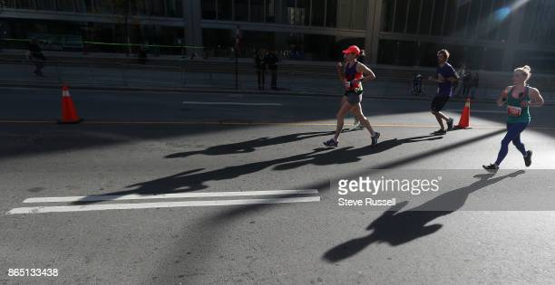 TORONTO ON OCTOBER 22 Runner make their way up the final stretch of Bay Street in the HalfMarathon during the Scotiabank Toronto Waterfront Marathon...