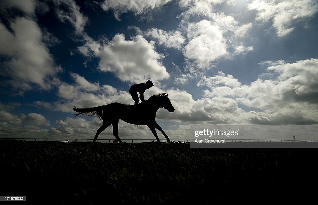 A runner makes its way to the start at Curragh racecourse on June 29, 2013 in Kildare, Ireland.