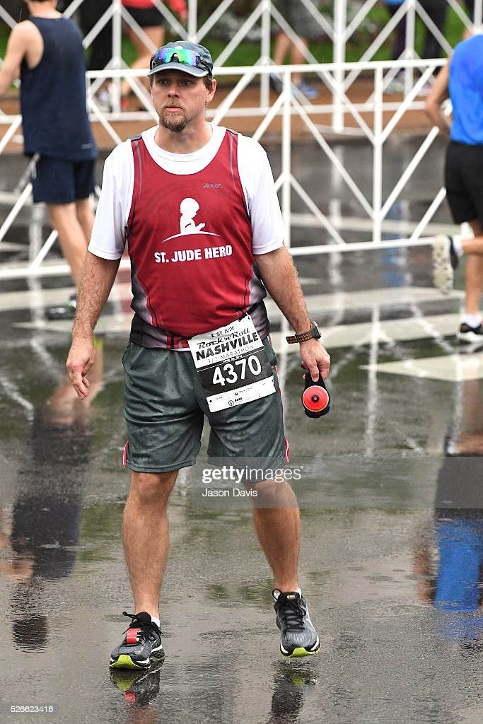 Runner Michael Artman participates in the St. Jude Rock 'n' Roll Nashville Marathon/Half Marathon and 5k where more than 34,000 participants weathered the rain during the 17th running on April 30, 2016 in Nashville, Tennessee.
