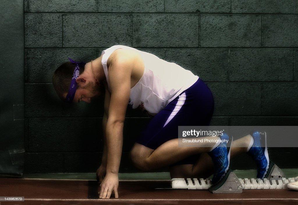 Runner on starting block : Stock Photo