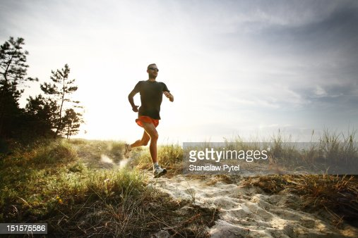 Runner on track at morning : Stock Photo