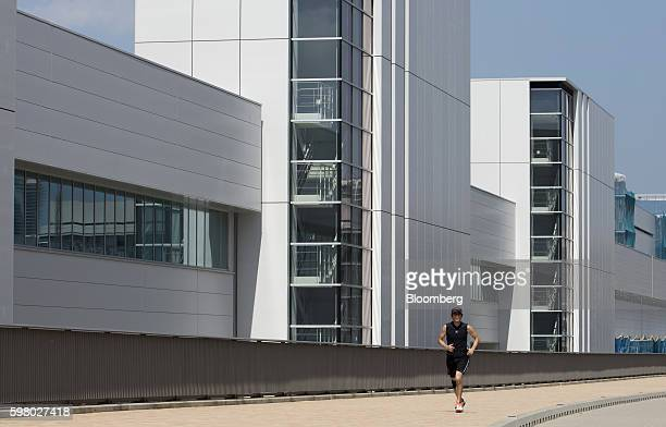 A runner passes by the under construction Toyosu Market in Tokyo Japan on Wednesday Aug 31 2016 Yuriko Koike governor of Tokyo announced Wednesday...