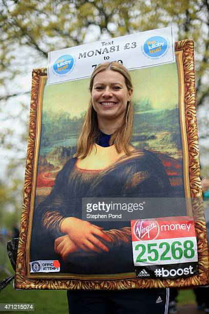 A runner poses for a photograph before the Virgin Money London Marathon on April 26 2015 in London England
