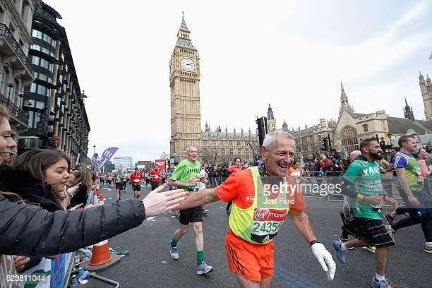 A runner receives support from the crowd as he passes Big Ben during the Virgin Money London Marathon on April 24 2016 in London England