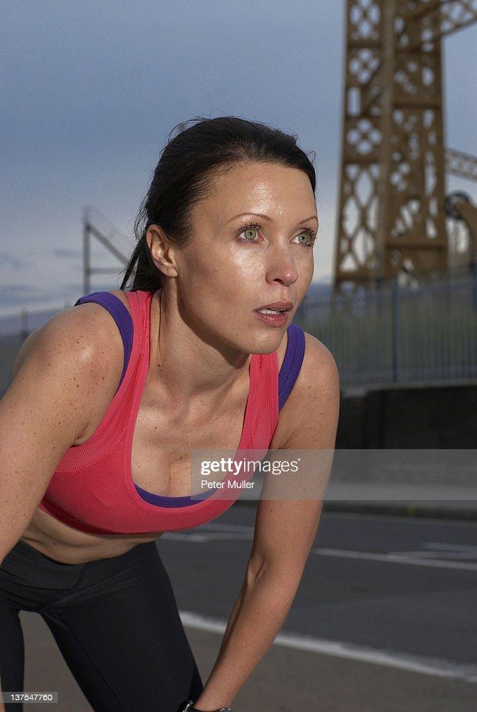 Runner resting on city street