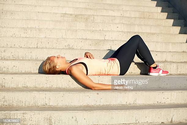 Runner resting on staircase