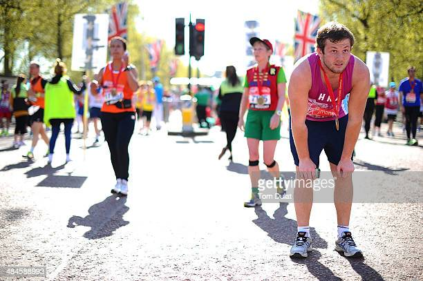 A runner rests after the Virgin Money London Marathon on April 13 2014 in London England