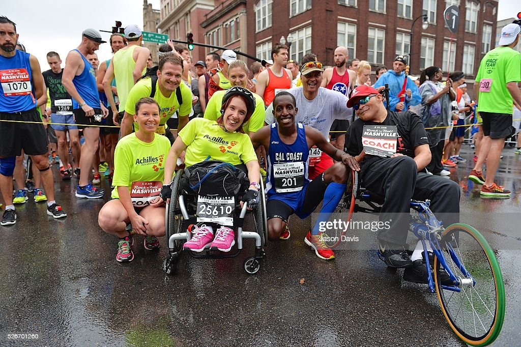 Runner Roosevelt Cook (Center; Blue) arrives at the St. Jude Rock 'n' Roll Nashville Marathon/Half Marathon and 5k where more than 34,000 participants weathered the rain during the 17th running on April 30, 2016 in Nashville, Tennessee.