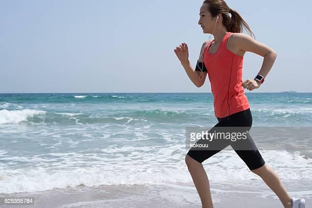 Runner running on the beach for training