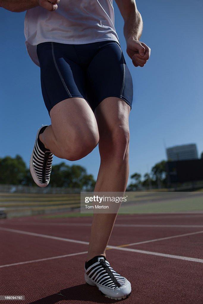 Runner running on track : Stock Photo