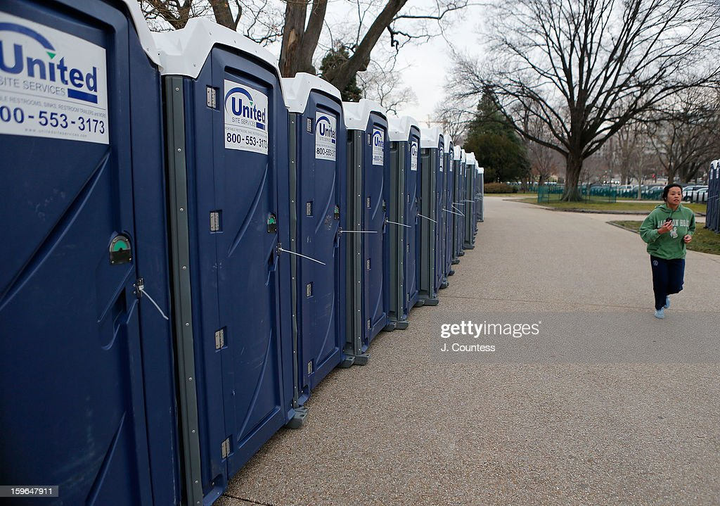 A runner runs past rows of porta potties set up in preparation for the inauguration ceremony for President Barack Obama on January 17, 2013 in Washington, United States. The inauguration ceremony is to take place on January 21, 2013.