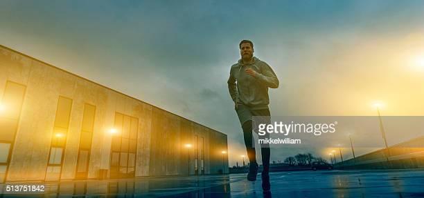 Runner runs through city at night