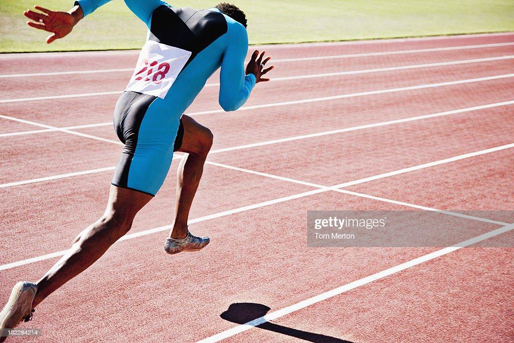 Runner sprinting on track : Stock Photo