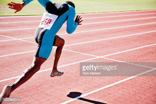 Runner sprinting on track