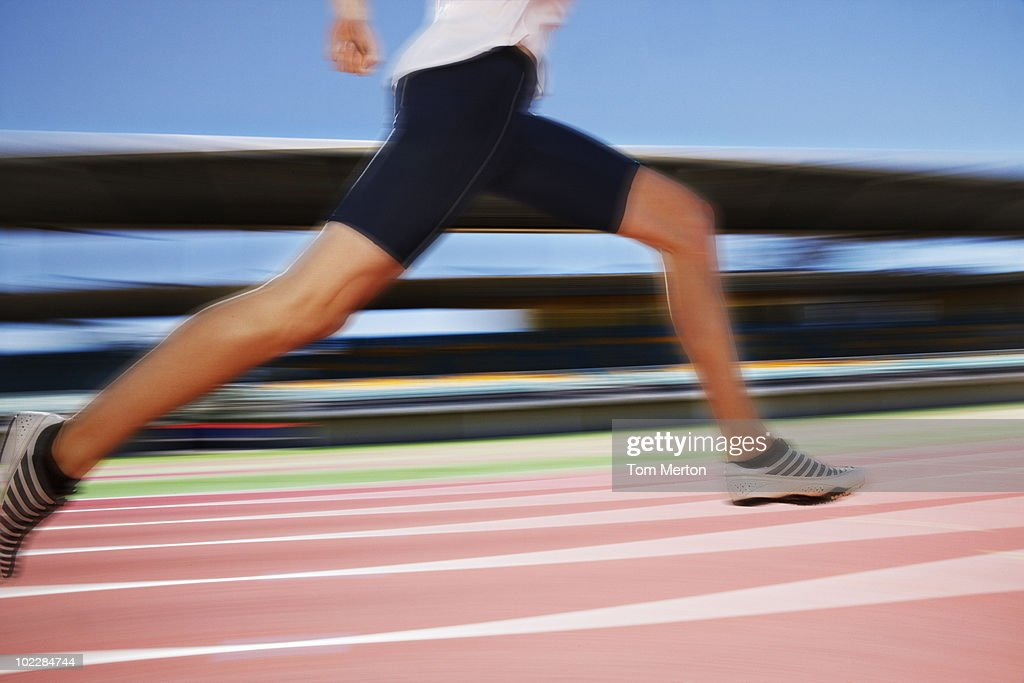 Runner sprinting on track : Stock Photo