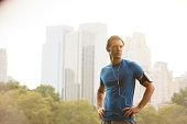 Runner standing in urban park