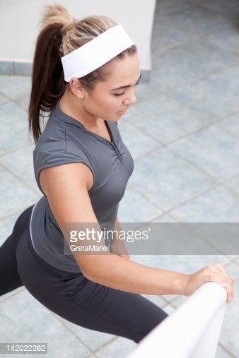 Runner stretching outdoors