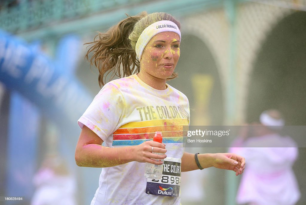 A runner takes part in The Color Run presented by Dulux, known as the happiest 5km on the planet on September 14, 2013 in Brighton, England. Runners of all shapes, sizes and speeds start wearing white clothing that is a blank canvas for the kaleidoscope of colours they encounter around The Color Run course. At each kilometre a different colour of powder is thrown in the air with the runners becoming a constantly evolving artwork. At the end of the course runners are greeted by the Colour Festival where the air is filled with music and stunning coloured powder bursts creating a vibrant party atmosphere.