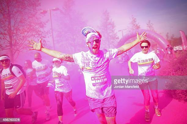 A runner takes part in the Color Run presented by Dulux known as the happiest 5km on the planet at Queen Elizabeth Olympic Park on September 28 2014...