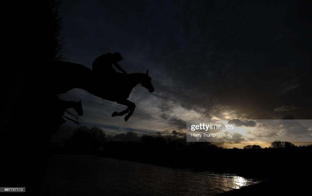 A runner takes the water jump during the Crestmoor Construction Handicap Chase at Wincanton Racecourse on December 7, 2017 in Wincanton, England.