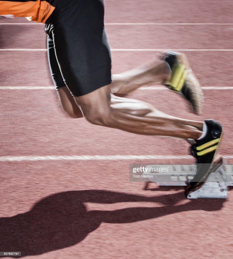 Runner taking off from starting block