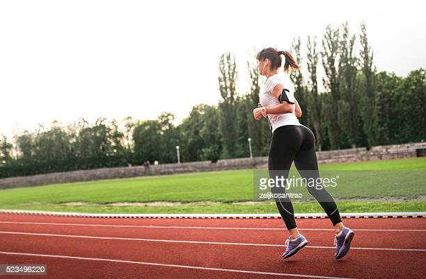 Runner trainning at a racetrack