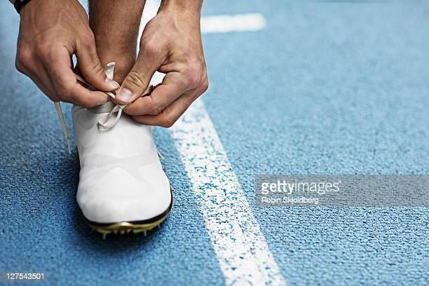 Runner tying shoelaces