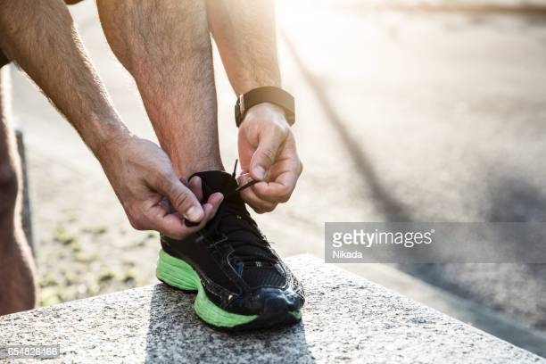 Runner tying up his shoelaces