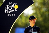 Runner up Andy Schleck of team Leopard Trek looks on from the podium after the twenty first and final stage of Le Tour de France 2011 from Creteil to...