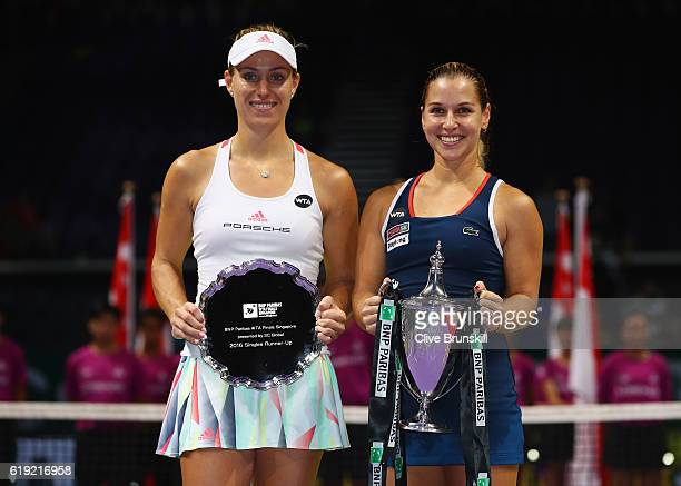 Runner up Angelique Kerber of Germany and Champion Dominika Cibulkova of Slovakia pose with their trophies after the singles final during day 8 of...