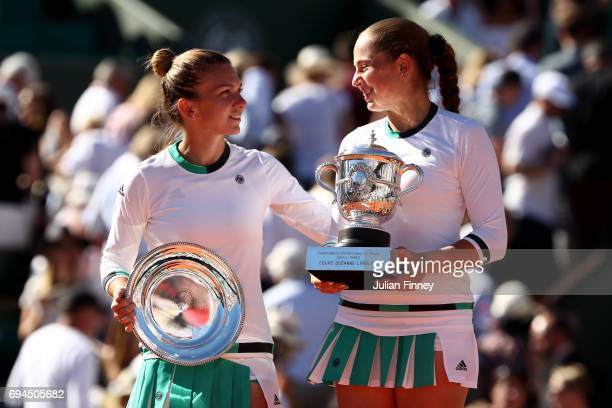 Runner up Simona Halep of Romania and Champion Jelena Ostapenko of Latvia pose for the cameras following their ladies singles final on day fourteen...