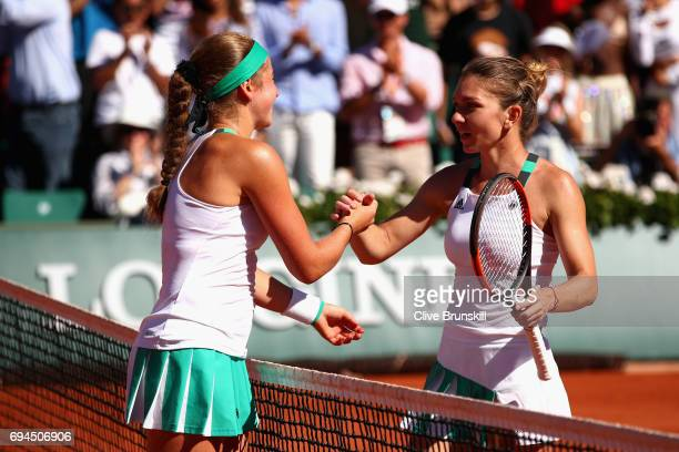 Runner up Simona Halep of Romania congratulates Jelena Ostapenko of Latvia on victory following the ladies singles final match on day fourteen of the...