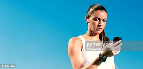 Runner use smart phone and smart watch