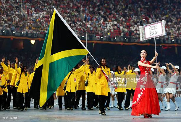 Runner Veronica Campbell of Jamaica carries her country's flag to lead out the delegation during the Opening Ceremony for the 2008 Beijing Summer...