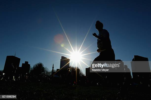 A runner warms up in the Boston Common before the 2016 BAA 5k on April 16 2016 in Boston Massachusetts
